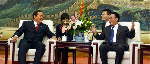 Venezuela's  Chávez (L) with Wu Bangguo (R), leader of China's Parliament, in Beijing (File photo credit: NYT)